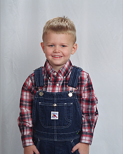 kid in overalls 